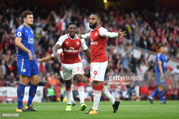 Alexandre Lacazette of Arsenal celebrates after scoring the opening goal during the Premier League match between Arsenal and Leicester City at the...