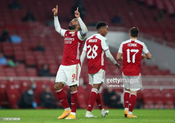 Alexandre Lacazette of Arsenal celebrates after scoring their team's first goal during the Carabao Cup Quarter Final match between Arsenal and...