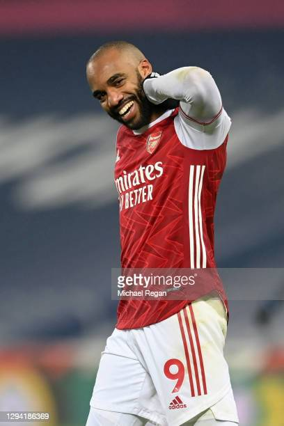 Alexandre Lacazette of Arsenal celebrates after scoring their team's fourth goal during the Premier League match between West Bromwich Albion and...