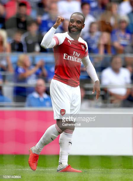 Alexandre Lacazette of Arsenal celebrates as he scores his team's third goal during the Premier League match between Cardiff City and Arsenal FC at...