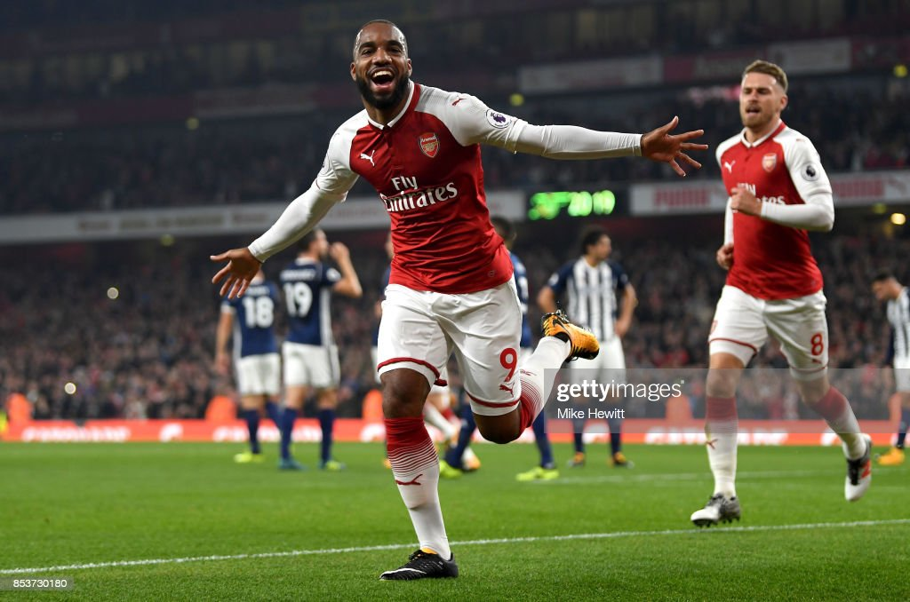 Alexandre Lacazette of Arsenal celebrates as he scores their first goal during the Premier League match between Arsenal and West Bromwich Albion at Emirates Stadium on September 25, 2017 in London, England.