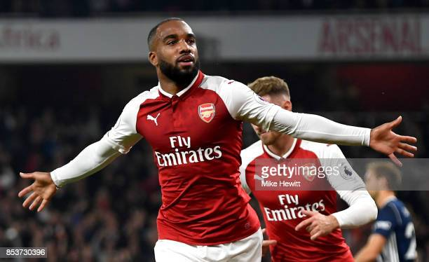 Alexandre Lacazette of Arsenal celebrates as he scores their first goal during the Premier League match between Arsenal and West Bromwich Albion at...
