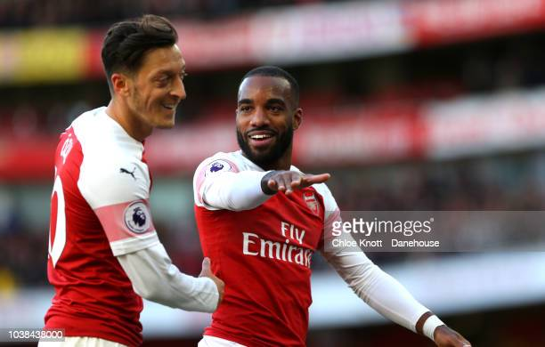 Alexandre Lacazette of Arsenal celebrates his first goal with Mesut Ozil of Arsenal during the Premier League match between Arsenal and Everton at...