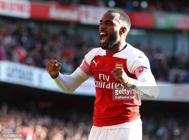 Alexandre Lacazette of Arsenal celebrates his sides second goal scored by Mesut Ozil during the Premier League match between Arsenal FC and Watford...