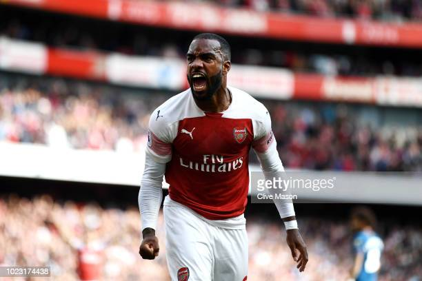 Alexandre Lacazette of Arsenal celebrates his team's second goal an own goal from Issa Diop of West Ham United during the Premier League match...