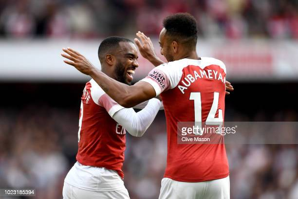 Alexandre Lacazette of Arsenal celebrates his team's second goal with PierreEmerick Aubameyang an own goal from Issa Diop of West Ham United during...
