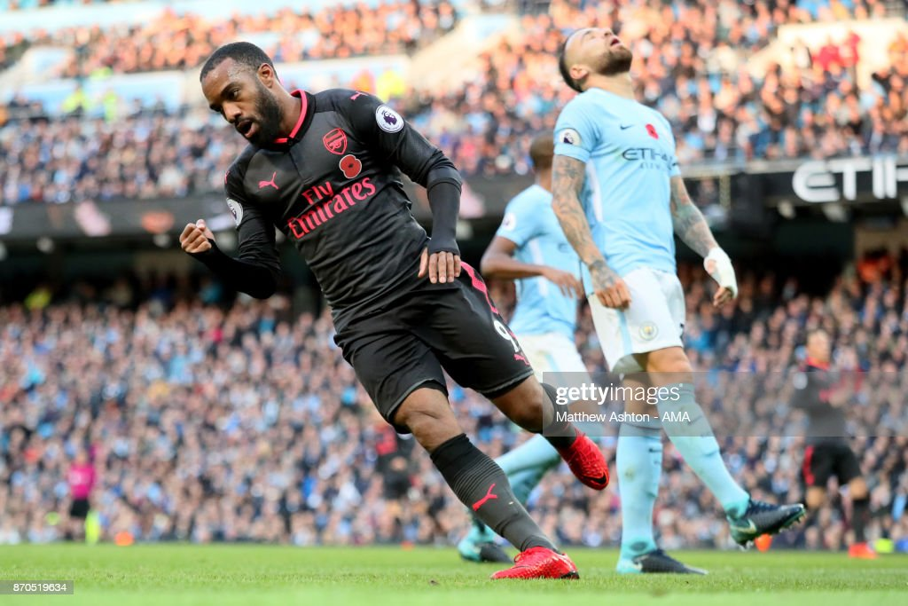 Alexandre Lacazette of Arsenal celebrates scoring a goal to make the score 2-1 during the Premier League match between Manchester City and Arsenal at Etihad Stadium on November 5, 2017 in Manchester, England.