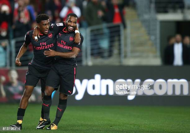 Alexandre Lacazette of Arsenal celebrates scoring a goal with team mate Alex Iwobi of Arsenal during the match between Sydney FC and Arsenal FC at...