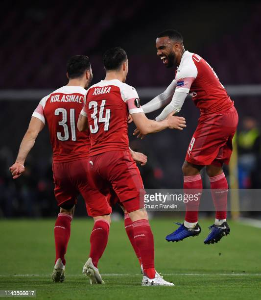 Alexandre Lacazette of Arsenal celebrates scoring his sides first goal with Granit Xhaka and Sead Kolasinac during the UEFA Europa League Quarter...