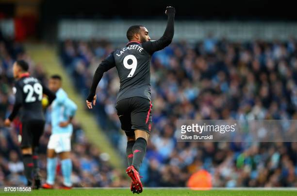 Alexandre Lacazette of Arsenal celebrates scoring his sides first goal during the Premier League match between Manchester City and Arsenal at Etihad...