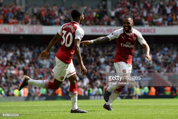 Alexandre Lacazette of Arsenal celebrates scoring his side's fourth goal with Ainsley MaitlandNiles during the Premier League match between Arsenal...