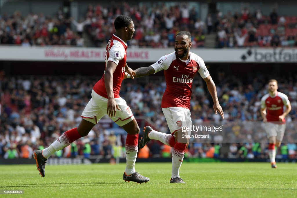 Alexandre Lacazette of Arsenal celebrates scoring his side's fourth goal with Ainsley Maitland-Niles during the Premier League match between Arsenal and West Ham United at Emirates Stadium on April 22, 2018 in London, England.