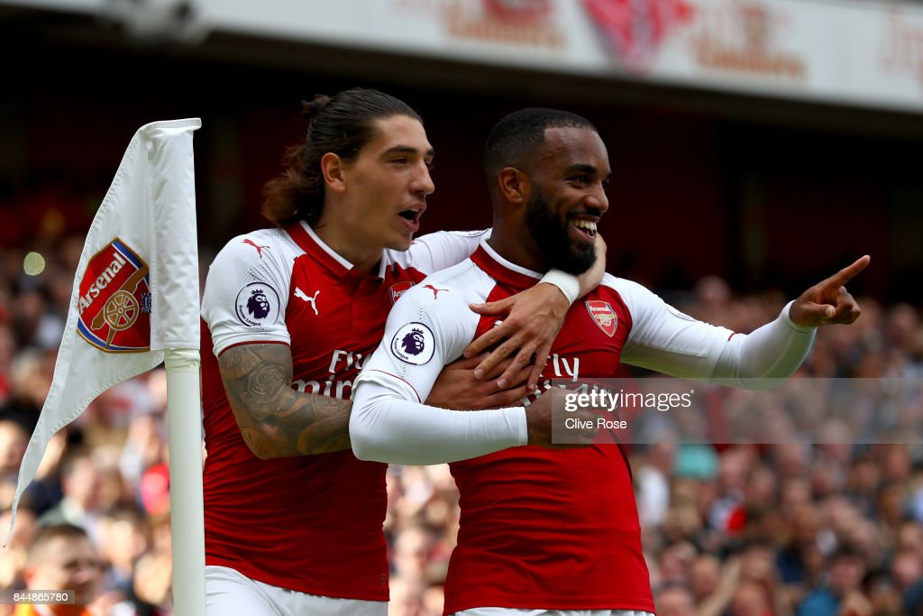 Alexandre Lacazette of Arsenal celebrates scoring his sides second goal with Hector Bellerin of Arsenal during the Premier League match between Arsenal and AFC Bournemouth at Emirates Stadium on September 9, 2017 in London, England.