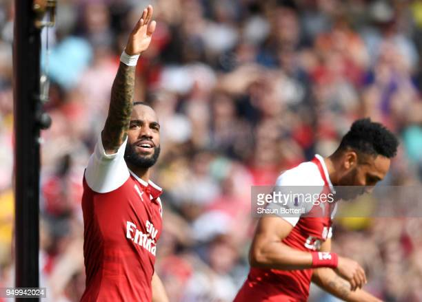 Alexandre Lacazette of Arsenal celebrates scoring his side's third goal during the Premier League match between Arsenal and West Ham United at...