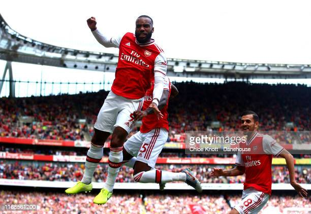 Alexandre Lacazette of Arsenal celebrates scoring his teams first goal during the Premier League match between Arsenal FC and Burnley FC at Emirates...