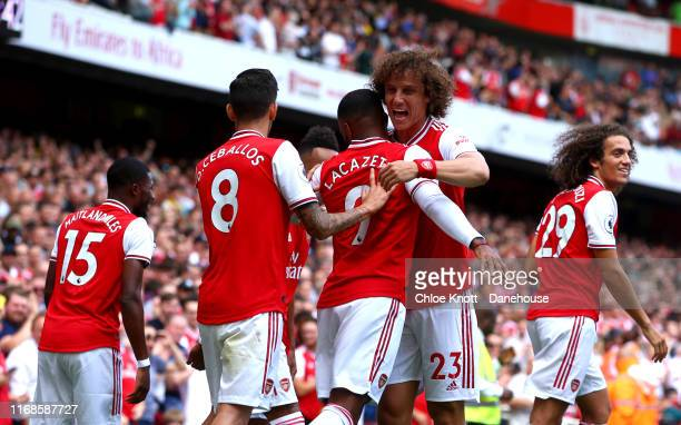 Alexandre Lacazette of Arsenal celebrates scoring his teams first goal with David Luiz of Arsenal during the Premier League match between Arsenal FC...