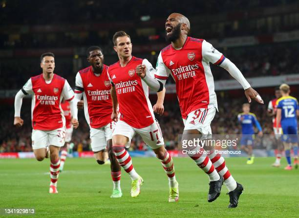 Alexandre Lacazette of Arsenal celebrates scoring his teams first goal during the Carabao Cup Third Round match between Arsenal and AFC Wimbledon at...