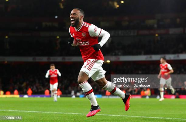 Alexandre Lacazette of Arsenal celebrates scoring his teams fourth goal during the Premier League match between Arsenal FC and Newcastle United at...