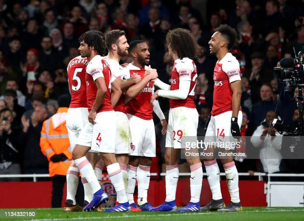 Alexandre Lacazette of Arsenal celebrates scoring his teams second goal during the Premier League match between Arsenal FC and Newcastle United at...