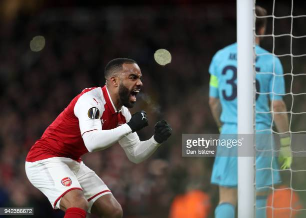 Alexandre Lacazette of Arsenal celebrates scoring the second goal from the penalty spot during the UEFA Europa League quarter final first leg match...