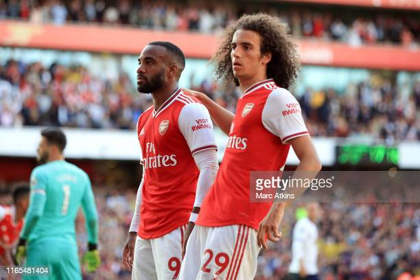 Alexandre Lacazette of Arsenal celebrates scoring their 1st goal with Matteo Guendouzi during the Premier League match between Arsenal FC and...
