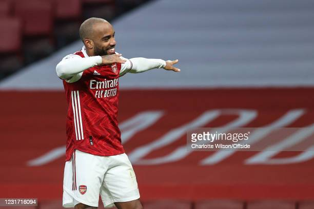 Alexandre Lacazette of Arsenal celebrates scoring their 2nd goal from the penalty spot during the Premier League match between Arsenal and Tottenham...