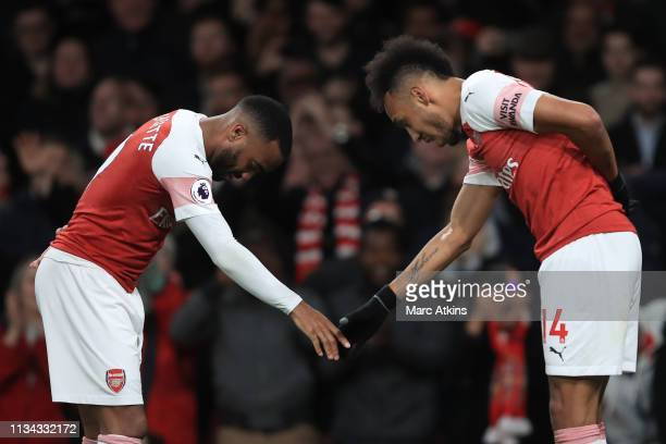 Alexandre Lacazette of Arsenal celebrates scoring their 2nd goal with PierreEmerick Aubameyang during the Premier League match between Arsenal FC and...