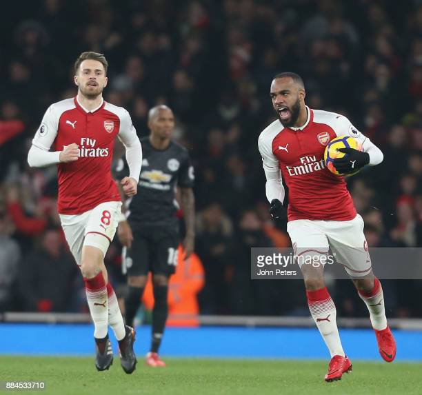 Alexandre Lacazette of Arsenal celebrates scoring their first goal during the Premier League match between Arsenal and Manchester United at Emirates...