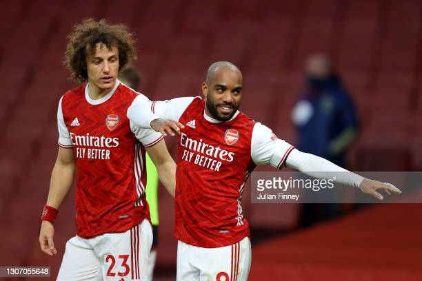 Alexandre Lacazette of Arsenal celebrates with David Luiz after scoring their side's second goal from the penalty spot during the Premier League...