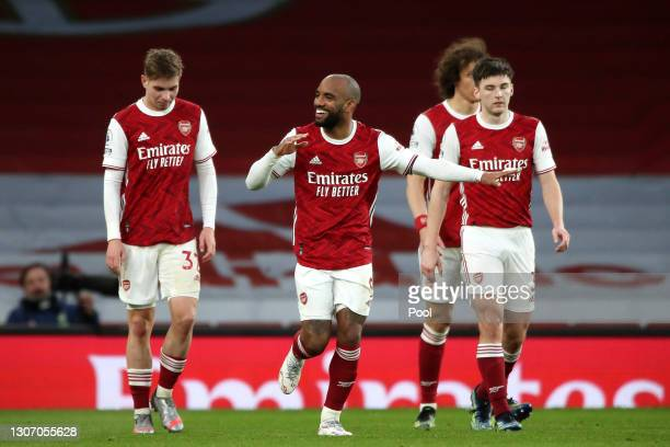Alexandre Lacazette of Arsenal celebrates with Emile Smith Rowe after scoring their side's second goal from the penalty spot during the Premier...