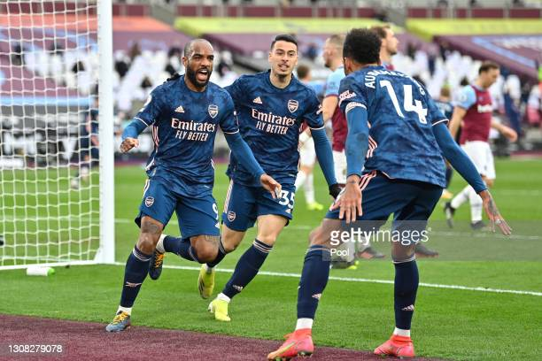 Alexandre Lacazette of Arsenal celebrates with Gabriel Martinelli and Pierre Emerick Aubameyang after scoring their side's third goal during the...