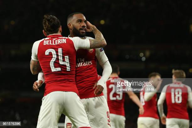 Alexandre Lacazette of Arsenal celebrates with Hector Bellerin of Arsenal after rumours of a training ground bust up earlier in the week after...