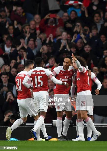 Alexandre Lacazette of Arsenal celebrates with his teammates after scoring his team's first goal during the UEFA Europa League Semi Final First Leg...