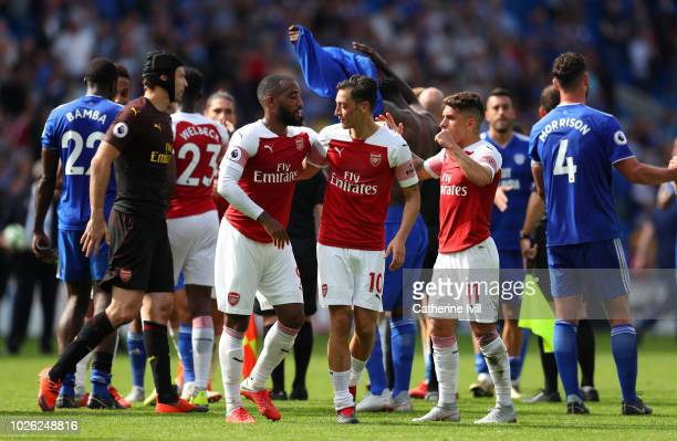 Alexandre Lacazette of Arsenal celebrates with Mesut Ozil of Arsenal after the Premier League match between Cardiff City and Arsenal FC at Cardiff...