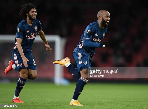 Alexandre Lacazette of Arsenal celebrates with Mohamed Elneny after scoring their team's first goal during the UEFA Europa League Group B stage match...