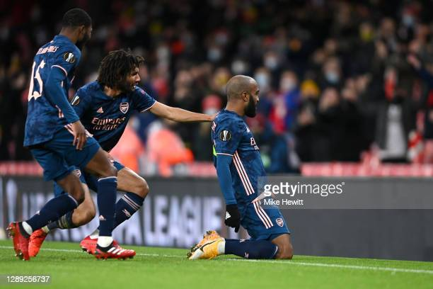Alexandre Lacazette of Arsenal celebrates with Mohamed Elneny and Ainsley Maitland-Niles after scoring their team's first goal during the UEFA Europa...