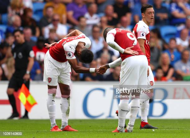 Alexandre Lacazette of Arsenal celebrates with PierreEmerick Aubameyang as he scores his team's third goal during the Premier League match between...