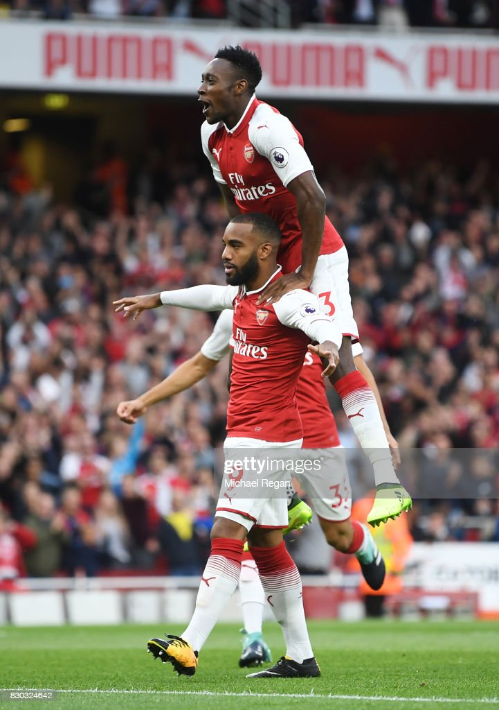 Alexandre Lacazette of Arsenal celebrates with teammate Danny Welbeck #23 after scoring the opening goal during the Premier League match between Arsenal and Leicester City at the Emirates Stadium on August 11, 2017 in London, England.
