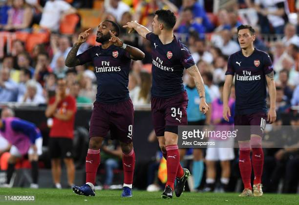 Alexandre Lacazette of Arsenal celebrates with teammate Granit Xhaka after scoring his team's second goal during the UEFA Europa League Semi Final...