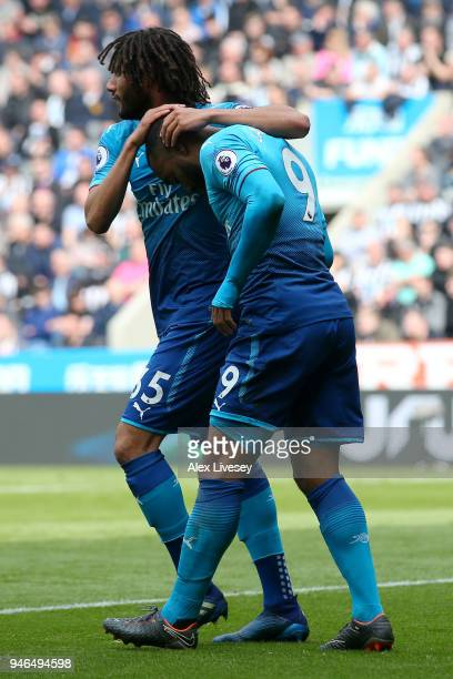 Alexandre Lacazette of Arsenal celebrates with teammate Mohamed Elneny after scoring his sides first goal during the Premier League match between...