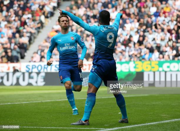 Alexandre Lacazette of Arsenal celebrates with teammate Nacho Monreal after scoring his sides first goal during the Premier League match between...
