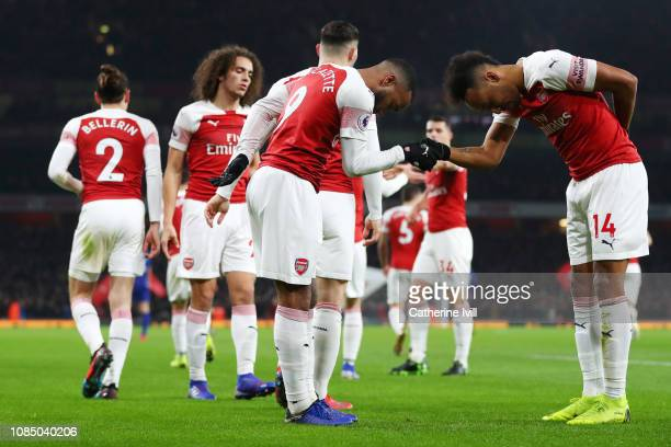 Alexandre Lacazette of Arsenal celebrates with teammate PierreEmerick Aubameyang after scoring his sides first goal during the Premier League match...