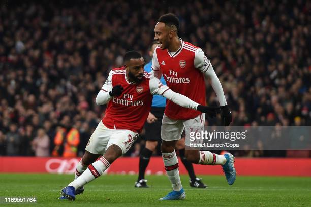 Alexandre Lacazette of Arsenal celebrates with teammate PierreEmerick Aubameyang after scoring his team's first goal during the Premier League match...