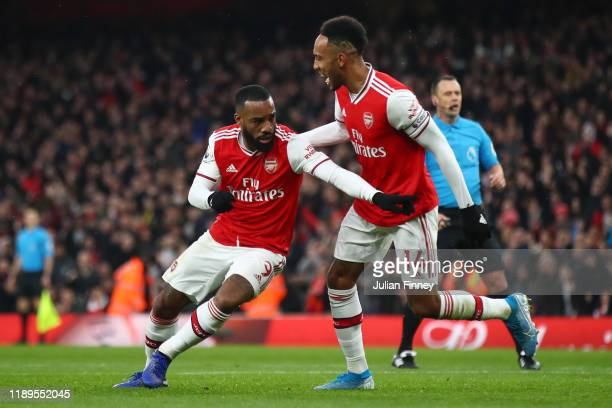 Alexandre Lacazette of Arsenal celebrates with teammate Pierre-Emerick Aubameyang after scoring his team's first goal during the Premier League match...