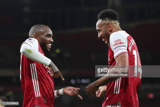 Alexandre Lacazette of Arsenal celebrates with teammate Pierre-Emerick Aubameyang of Arsenal after scoring their 1st goal during the Premier League...