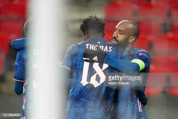 Alexandre Lacazette of Arsenal celebrates with teammate Thomas Partey after scoring their team's fourth goal during the UEFA Europa League Quarter...