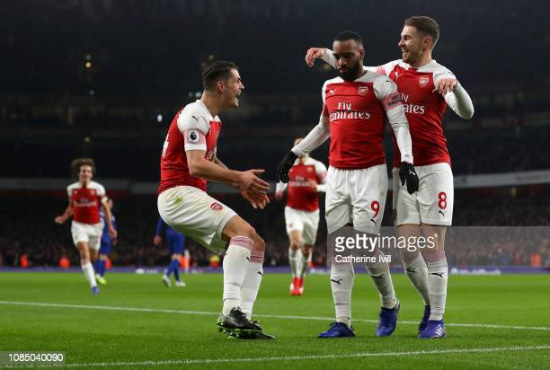 Alexandre Lacazette of Arsenal celebrates with teammates Aaron Ramsey and Granit Xhaka after scoring his sides first goal during the Premier League...