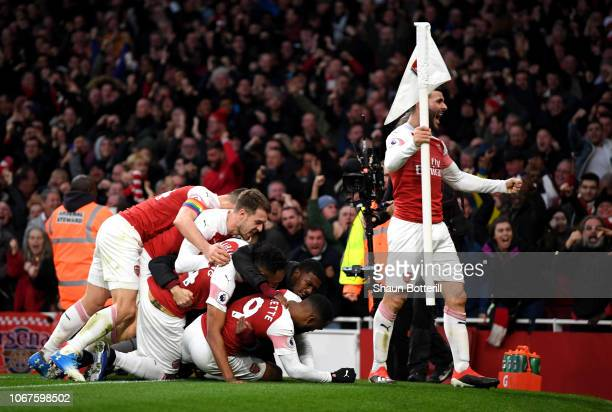 Alexandre Lacazette of Arsenal celebrates with teammates after scoring his team's third goal during the Premier League match between Arsenal FC and...
