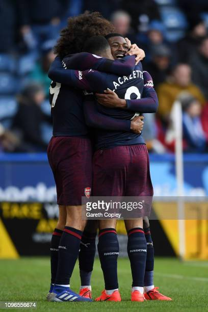 Alexandre Lacazette of Arsenal celebrates with teammates after scoring his team's second goal during the Premier League match between Huddersfield...