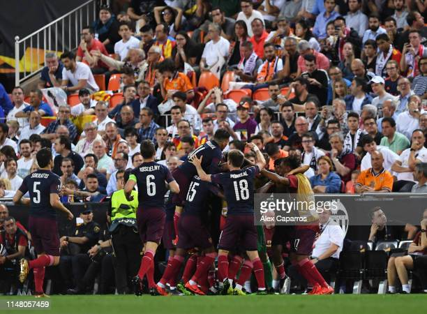 Alexandre Lacazette of Arsenal celebrates with teammates after scoring his team's second goal as Lucas Torreira of Arsenal jumps on top during the...